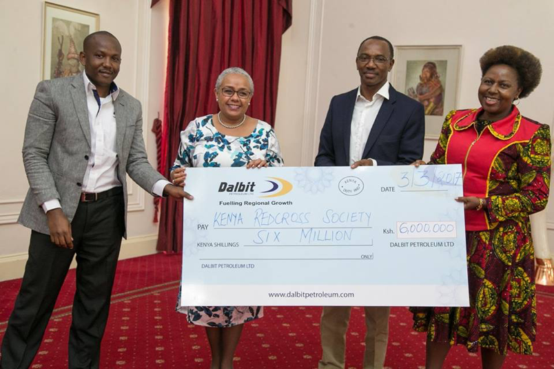 Kenya's First Lady Margaret Kenyatta receives a cheque from Dalbit Group's Chairman Humphrey Kariuki at State House, Nairobi. Also present is Group Managing Director Margaret Mbaka and the Group Corporate Affairs Manager Anthony Kagiri.