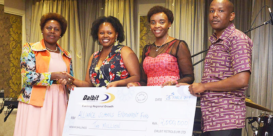 Managing Director - Margaret Mbaka, Human Resource Director - Hellen Akello and Corporate Affairs Manager - Anthony Kagiri proudly handing over a Kes 2,000,000 cheque to the Alliance Schools Endowment Fund in 2017.