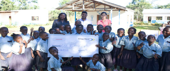 Group Managing Director Margaret Mbaka with the Sales Director Mr. Vinod Unithan handing over a cheque to the school.